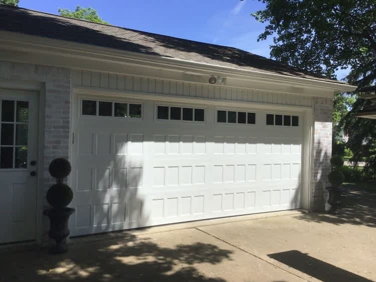 """alt=""""south lyon garage door install. Safe-way double door in white"""""""
